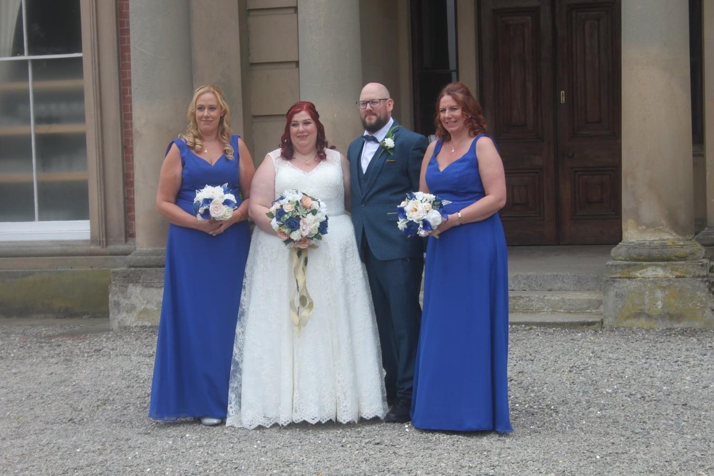 Elena Armitt with her bridesmaids and husband