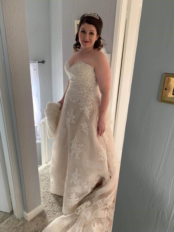 Lizzie Tomkinson in her pink lace wedding dress